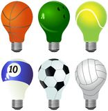Set of different light bulbs designed as sporting balls Royalty Free Stock Photography