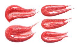 Set of different lip glosses smear isolated on white. Smudged makeup product sample. Stock Images