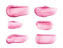 Set of different lip glosses smear samples isolated on white. Smudged makeup product sample Royalty Free Stock Images