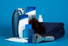 Set of different men's cosmetics. On a blue background royalty free stock photo