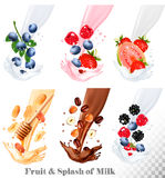 Set of different milk splashes with fruit, nuts and berries. Stock Images