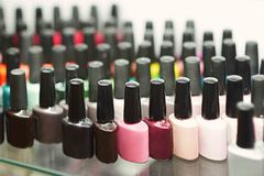 Set of different nail varnishes on shelves in cosmetic beauty saloon Royalty Free Stock Image