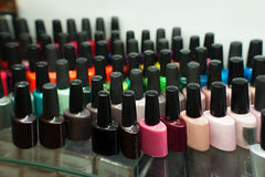 Set of different nail varnishes on shelves in cosmetic store Royalty Free Stock Photo