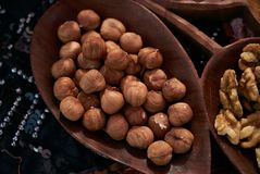 Set of different nuts, almonds, walnuts, hazelnuts  in brown wooden bowl Stock Images
