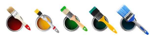 Set of different paint brushes and cans on white background. Top view stock photo