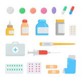 Set of different pills and drugs. First-aid kit contents medication, drops, tablet, syringe, thermometer, plaster. Inhaler, capsule, vial medicine bottle Stock Photo