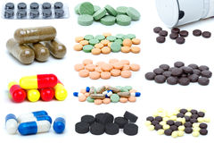 Set of different pills and tablets. Isolated on the white background Royalty Free Stock Photo