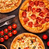 Set of different pizzas - pepperoni, vegetarian, chicken with ve stock photo