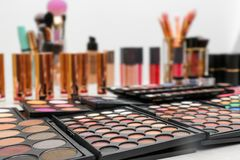 Set of different professional makeup products. On table royalty free stock photo