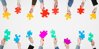 Set different puzzle pieces in people hands Royalty Free Stock Images