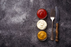 Set of different sauces: mustard, ketchup, mayonnaise. Stock Images