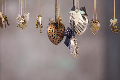 Set of different shape pendants made of metal Stock Photos