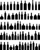 Set of different silhouettes bottles isolated on Stock Images