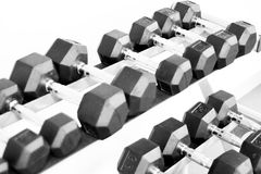 Set of different size weights on a table Stock Photos