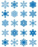 Set of different snowflakes. Set of different blue snowflakes on a white background Stock Images