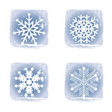 Set on different snowflakes icons. Set on different snowflakes grunge icons Royalty Free Stock Images