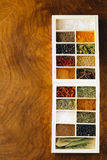 Set of different spices (pepper, salt, turmeric, bay leaves, chili, herbs) Stock Photography