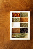 Set of different spices (pepper, salt, turmeric, bay leaves, chili, herbs) Stock Photo