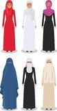 Set of different standing arab women in the traditional muslim arabic clothing isolated on white background in flat Royalty Free Stock Photos