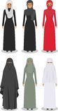 Set of different standing arab women in the traditional muslim arabic clothing  on white background in flat Stock Photography