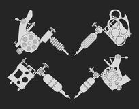 Set of 4 different style tattoo machines. Chalk. Set of 4 different style realistic tattoo machines icons. Revolver tattoo machine, knuckle duster tattoo gun Royalty Free Stock Photography