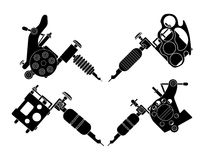 Set of 4 different style tattoo machines. Set of 4 different style realistic tattoo machines icons. Revolver tattoo machine, knuckle duster tattoo gun. Invert Stock Photos