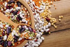 Vegan protein source. Legumes - lentils, chickpeas, beans, green mung bean, seeds and nuts on wooden background. Top view stock image