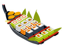 Set of different sushi and sashimi in a wooden boat. Stock Photography
