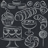 Set of different sweetmeats on blackboard Stock Images