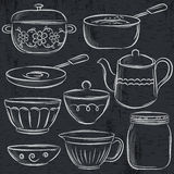 Set of different  tableware on blackboard Royalty Free Stock Photos