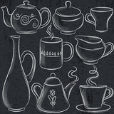 Set of different  tableware on blackboard Stock Photos