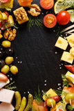 Set of different tasty appetizers, snacks  and ingredients on a black background Royalty Free Stock Image