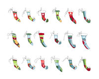 Set of different textile Santa socks isolated on white. Bright colors. Stock Photo