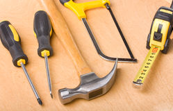 Set of different tools. On wooden background Royalty Free Stock Image