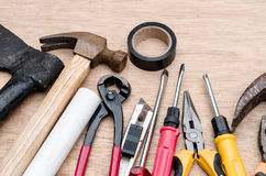 Set of different tools for work on wood background Royalty Free Stock Photos