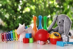 Set of different toys on table. Against blurred background stock images