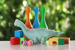Set of different toys on table. Against blurred background royalty free stock photos