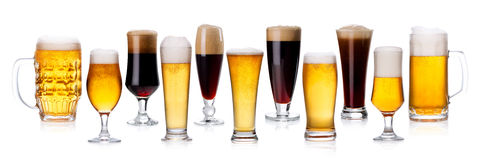 Set of different types of beer with foam in glasses isolated on Royalty Free Stock Photography