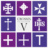 Set of different types of crosses on purple background Stock Photos