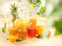The set of different types of juices. On a wooden table royalty free stock photo