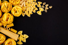 Set of different types of pasta on the black background Stock Images