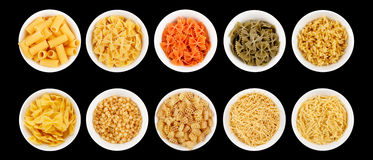 Set of different types of pasta on the black background Stock Photos