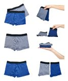 Set of different Underpants and clothing for kids with hand isolated on white background. Set of different Underpants and clothing for kids with hand isolated Royalty Free Stock Photos