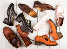 Set of different unisex shoes on wooden background royalty free stock image