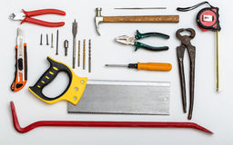 Set of different used tools on white plate Royalty Free Stock Images