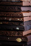 Set of different varieties of chocolate with nuts, raisins Royalty Free Stock Images