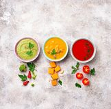 Set of different vegetable cream soups Stock Photos