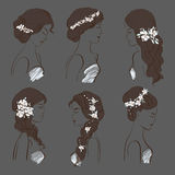 Set of different wedding hairstyles for brunettes with flowers on a dark background Royalty Free Stock Images