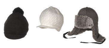 Set of different winter hats isolated on white. Set of different winter hats Stock Photos