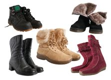 Set of different wintry boots Royalty Free Stock Photo
